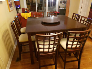 Dinning table with leaf, 8 chairs and matching lazy Suzan