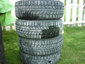 4 - 15IN. STUDDED TIRES 195/65R15 4 LUG RIMS OFF 2004 CHEV OPTRA
