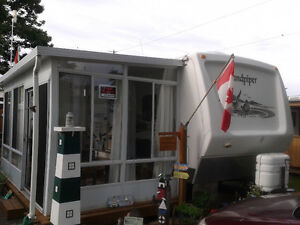 30 Ft. Sandpiper Trailer with Two Slideouts & Attached Sun Room