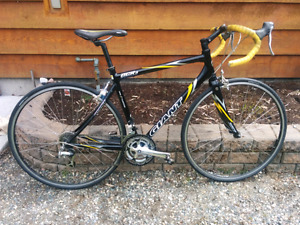 Giant OCR3 roadbike with Rockhopper shoes and windtrainer