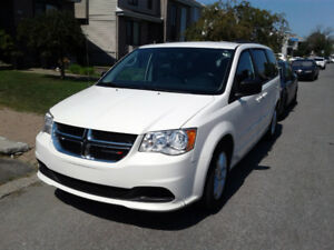 2013 white Grand Caravan Stow n Go with DVD