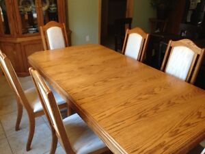 Solid oak table and chairs with display hutch