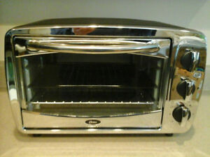 Next To New and Shiny!!! Toaster oven for ALL your tasty treats!