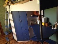 Loft bed with desk and wardrobe under