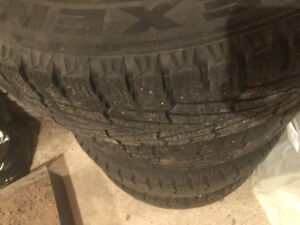 Studded winter tires with rims - 215/70/16