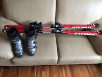 Girls atomic 150cm skis and Nordica boots