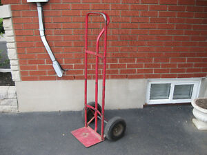 Good heavy duty dolly with 10 1//2 inch tires with tubes $65.00