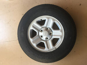 Brand new stock Jeep Wrangler tire with rim