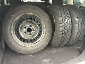 Four Winter Tires on rims (only used one season!)