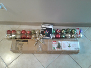 Christmas tree with ornaments, lights and star