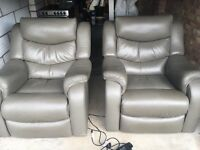 Two leather reclining chairs for sale