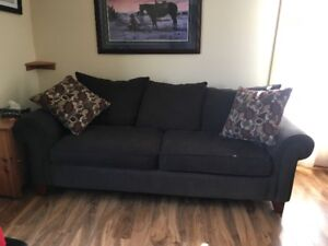 Brown Couch, Chair and Ottoman with accent pillows