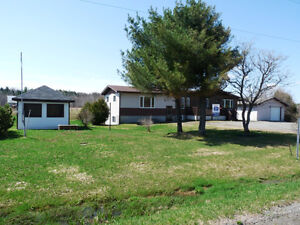 COUNTRY LIVING OR HOBBY FARM!  WATERFRONT! 4.4 ACRES!