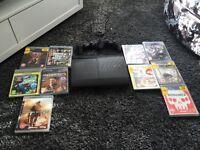PS3 slim + 10 games + 2 pads