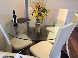 Glass Dining table and six chairs