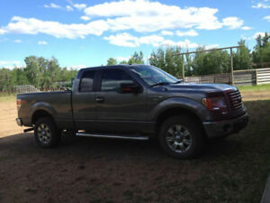 2010 Ford F-150! Grey half ton truck. Reliable, in good shape.