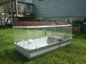 Large animal cage for sale! (Rabbit food and bedding included)