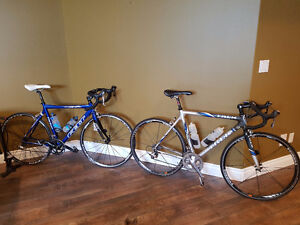 His & Hers - Two All-Carbon High-End Road Bikes and Accessories