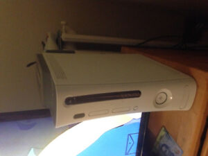 Xbox 360, 60 GB with 18 games, 2 controllers, one mic