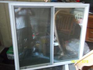 Used, good condition  All Vinyl slider windows