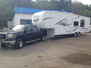 Price drop!! 2009 5th wheel with bunkhouse