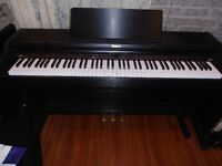 Digital piano Roland 201.  Never being used. Free delivery & ins
