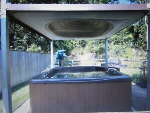 Beachcomber Hot Tub with electric hard top cover