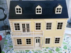 Beautiful large yellow dolls house