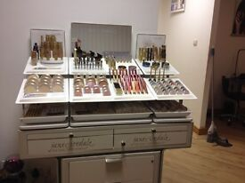 Jane Iredale deluxe stand with tester products