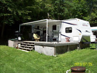 Like new 2010 Jayco jayflight with deck on seasonal lot
