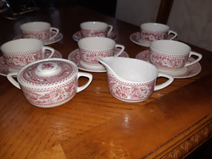 Beautiful porcelain set of  6  teacups with saucers ,creamer and