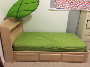 Kids bed with built in drawers