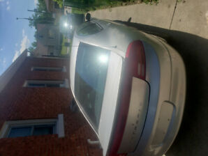 2001 silver intrepid.  As is