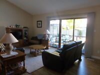 Large, bright town-house at Conestoga & Springbank, avail. Feb 1