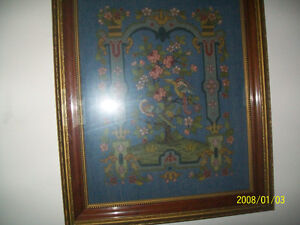 prize winning needlepoint in an a mahogany frame