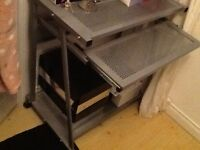 Silver computer desk with sliding shelve