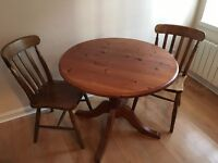 Wooden pedestal dining table and chairs