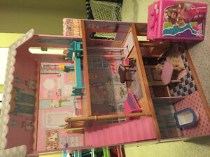 Barbie house and case, dolls and clothing