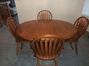 Dark oak dining table with 4 chairs
