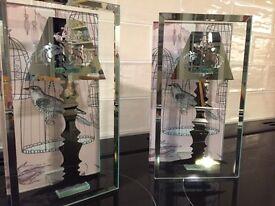 A pair of unusual glass tea light holders