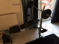 Weight bench and weights 2 5kg 2 7.5kg and weights bar