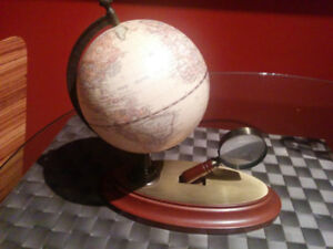 Globe and magnifying glass ornament
