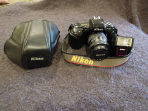 Nikon filmed based F-601 SLR camera and flash