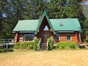 Custom built log home on 4.84 acres with heated 28x36 shop