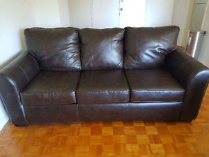 Brown leather couch and ottoman