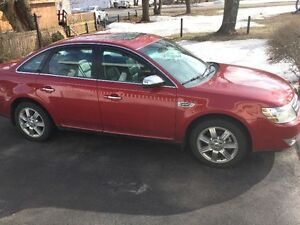 2009 Ford Taurus Scarlet Sedan