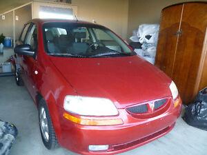 2007 Pontiac Wave hatchback , brand new winter tires& receipt