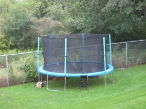 Trampoline - 14 ft wide ,  2 summers old , rarely used.