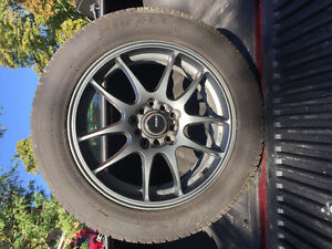 "16"" universal rims with 205/55/r16 tires - 80% tread"