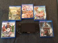 Ps vita with 5 games and charger